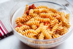 Pasta with the easiest ever tomato sauce made with whole canned tomatoes, butter, sugar, basil, and salt and pepper.