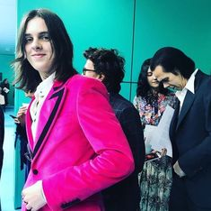 Earl Cave walks ahead of his parents at Gucci Red Right Hand, Nick Cave, Punk Goth, Milan, Beautiful People, Leather Jacket, Singer, Actors, Blazer