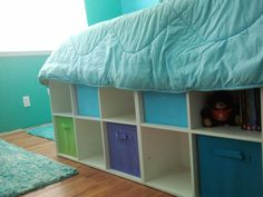 Closetmaid Cubeicals Platform bed sides  - After measuring my daughter's double bed, I used a 6 cube and an 8 cube bolted together. The same is on the other side for plenty of storage options for my preteen daughter.  I placed felt on the bases so we could slide the completed bed over the new Pergo floor.