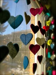 felt heart window hangers- machine stitch spacing in between hearts without cutting to create garland