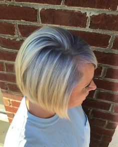 Platinum with some lavender roots by Christel at Vintage Hair Salon in Smyrna, GA