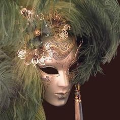Full-faced gold mask. Love the feathers!