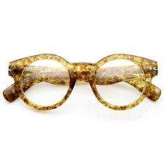 • Description • Measurements • Retro inspired round p3 wayfarer that features a bold horned rim , metal shaped rivets on the temples and a key hole nose bridge. The unique tortoise shell frame pattern is a wonderful addition to this season's collection! Made with a plastic based frame, metal hinges and clear polycarbonate UV protected lenses. • Lens Width: 45mm Nose Bridge: 18mm Lens Height: 42mm Total Width: 130mm