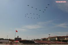 """Chinese People's Liberation Army CAIC Z-10 helicopters flying in the formation """"70"""" over Tiananmen Square in Beijing at the 2015 Chinese V-J Day Parade, marking the 70th anniversary over the defeat of the Empire of Japan in World War II."""