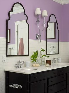 White subway tile is paired with bright lavender walls for a fun and casual guest bathroom. (Photo: Tria Giovan) -- i love love love the mirrors!