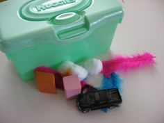 Touch and feel box.  You will need a wipes container that has a rubbery opening ( a kleenex box works well too) , soft items like cotton balls, feathers, small pieces of fleece, and harder objects like blocks, keys and toy cars.