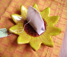 """Sunflower Trinket Dish Perfect as a jewelry tray, catch-all, votive candle holder, spoon rest, tea bag plate. Food and dishwasher safe Measures 4.5""""x 4.5""""x.5"""" Handmade in Ohio"""