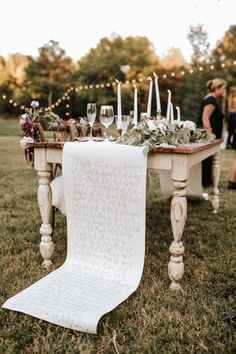 Scripty + chic  paper table runner from this Southern boho wedding reception in Georgia | Image by Vic Bonvicini