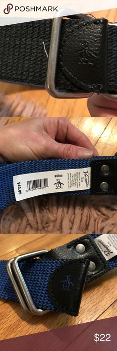 "Original penguin reversible belt ""unisex BNWT. Thick canvas unisex reversible belt. Retails 40$. Width: 1.5"" length; 45"" long. This belt is a gorgeous blue on one side and black on the other with a ""pewter"" color D ring hooks, so very versatile and flexible. This will become your ""go to"" belt. BNWT. Original Penguin Accessories Belts"