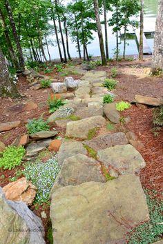 mossy and rock walking path Repurposed History Home on Lake Wedowee