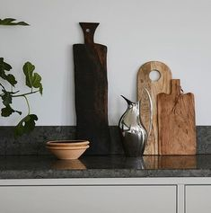 Wooden details in this grey kitchen by us. Styling: @sundlingkicken Photo: @fanny_hanssons