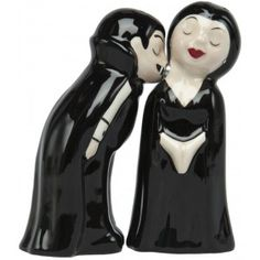 (one of my prized pieces) It was love at first bite for this pair here! This ceramic salt & pepper set includes a vampire, undead bride dressed in black & are held together with a pair of magnets.