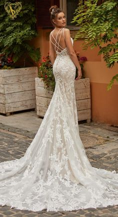 Glamorous lace mermaid wedding dress with long train, criss cross open back | Val Stefani Spring 2021 Wedding Dress - London/D8261 - Belle The Magazine #weddingdress #weddingdresses #bridalgown #bridal #bridalgowns #weddinggown #bridetobe #weddings #bride #dreamdress #bridalcollection #bridaldress #dress See more gorgeous bridal gowns by clicking on the photo