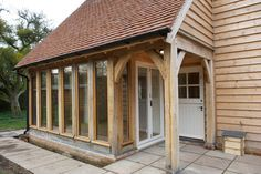 Barns & Contemporary - Border Oak - oak framed houses, oak framed garages and structures. Porch Extension, Cottage Extension, Extension Ideas, Garden Room Extensions, House Extensions, Kitchen Extensions, Oak Framed Buildings, Modern Buildings, Oak Framed Extensions