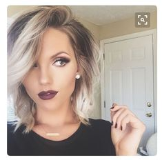 Silver platinum blonde ombré dark roots lob haircut
