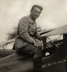 French ace pilot Lieutenant Rene Fonck sits atop his WWI airplane - 42-26892021 - Rights Managed - Stock Photo - Corbis