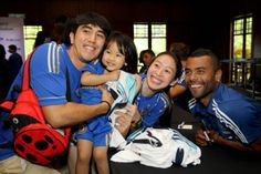BLUES FAMILY ... Ashley Cole poses with fans during Chelsea FC's meet-and-greet session at the Saujana Hotel today.