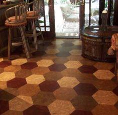 cork flooring in honeycomb/hexagonal tiles. sustainable flooring. eco friendly. beautiful.