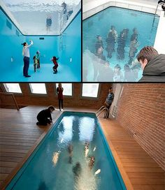 Underwater art illusion. People are standing in an empty pool with glass above it covered with water, making it look like people are walking underwater.