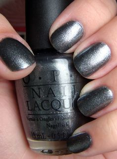 OPI's Lucerne-tainly Look Marvelous is from their Swiss Collection for Fall 2010. What a fabulous colour! A gorgeous charcoal (reminds me of pencil lead) polish chock full of foil shimmer. It glitt...