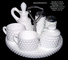Milk Glass - Something my Momma loves! Fenton Milk Glass, Fenton Glassware, Antique Glassware, Vintage Dishware, Vintage Canisters, Condiment Sets, Or Antique, Antique Dishes, Carnival Glass