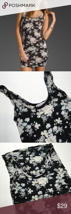 Gorgeous Floral Soft Dress  Extremely soft thin fabric. Stretchy. Great condition. Cute Tank dress or tunic to wear with leggings. Should fit a small/medium.  Brandy Melville Dresses Mini