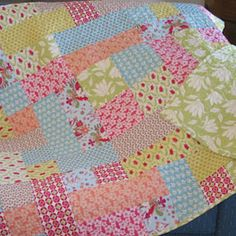 """Mad Patcher Quilt: (Reminds me of my Mom's quilts) This is an easy piece to quilt using 10 fat quarters and additional yardage for the backing. The key to this pattern is its symmetrical look. Finished size is 45"""" x 52""""."""