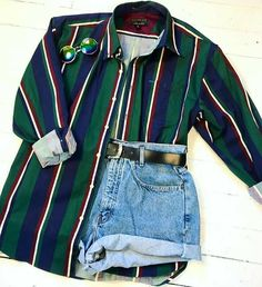 Green button-down shirt and jeans shorts. Summer fashion - top trends - Green button-down shirt and jeans shorts.
