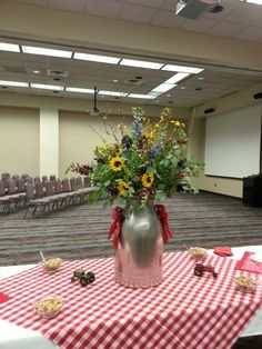 Old milk jug with bandanas and flowers for a farm/country themed retirement party