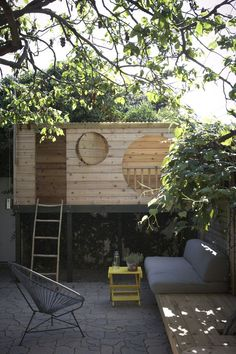 Extend the modern treehouse to the left, cutting a hole through for the tree?