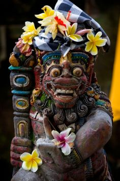 Statue adorned with flowers, Bali, Indonesia