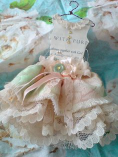 Mini paper & fabric party dress - maybe a party favor, invite, change it into a picture holder maybe?