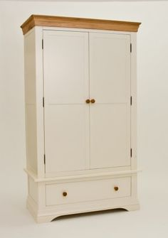 Solid oak frame and tops.  https://www.oakfurnituresolutions.co.uk/p/11959/Bordeaux_Painted_Double_Wardrobe_with_Drawer.html