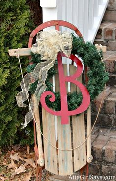 decorated Christmas sled pinned more than 5000 times. So easy but so pretty. Click for more great holiday decorating ideas inside and ouf.