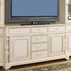 "Six-drawer media console with turned detailing and an integrated power outlet.   Product: Media consoleConstruction Material: WoodColor: Distressed linenDimensions: 36"" H x 66"" W x 22"" D"
