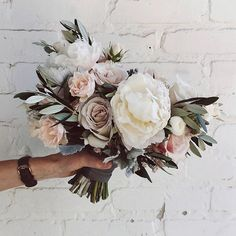 For Cheryl today, a beautiful bridal bouquet. Including olive, ranunculus, dusty…