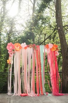 wedding ceremony backdrop bright ribbons and flowers, paper flowers and fresh flowers
