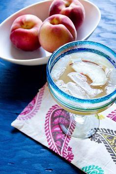 White Peach Margaritas: 4 oz silver tequila - 3 oz white peach puree - 4 oz triple sec - 1 lime, juiced. Stir together and serve.