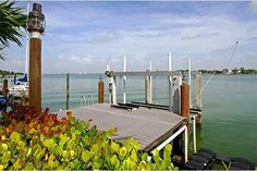 Biscayne Point Island, spacious open living, dining and family rooms with immediate grand wide bay views. A large eat-in kitchen features newer SS appliances, granite counters, double sink. Four comfortable bedrooms, one private w/separate entry, waterfront master overlooks freeform pool, dock with boat lift. A circular driveway, lush landscaping makes this 50's GEM the perfect waterfront!  For more information about this property, contact Nancy W. Batchelor at 305-329-7718
