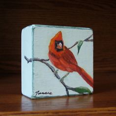 Red cardinal is an original oil painting on a small wood block. Miniature cardinal bird painting in bright red. Approximately 3 x 3 x 1 1/2 . I