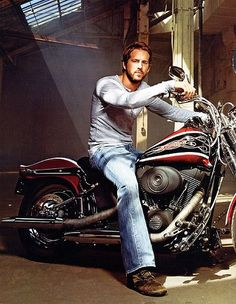 Ryan Reynolds on a bike. God is GOOD! What a fine man on a beautiful piece of machinery.