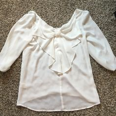 3 quarter length, white flowy shirt White, sheer. 3 quarter length sleeves. Cute bow on BACK of shirt. Tops Blouses