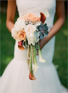 I like the subtle touch the string of pearls brings to this bouquet.
