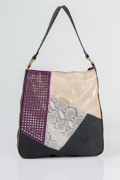 This hobo bag handmade from variety of soft leather. It is a rich patchwork of diversely colored leather pieces, and decorated with Nutopa's signature, hand applied studs.
