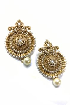 Pearl embellished danglers in white
