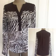 """30% OFF BUNDLES🎉HP🎉Michael Kors Brown Zebra Top Stand out from the crowd of neutral dressers in this zebra striped Henley from MICHAEL Michael Kors. Measures 18"""" across bust line, 24"""" in front length, 26"""" in back length and has approximately 24"""" sleeves.  •Featured in brown & white •Slit V-neck •Contrast black shoulder yoke and placket trim •Long sleeves with banded buttoned cuffs •Three front button placket •Allover zebra striped pattern •High-low hem •Made of viscose MICHAEL Michael Kors…"""