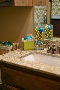 Christmas decor idea || for the bathroom -- use the same color scheme of the towels & shower curtain already in your bathroom for ornaments & other Christmas decor