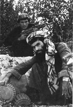 A pair of Mujahideen fighters pose with anti-tank mines as they place them to blow up a pipeline. (Collection of David Isby), pin by Paolo Marzioli