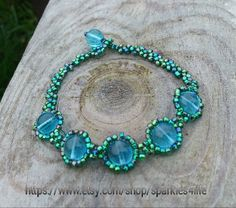Blue beads surrounded by blue/green beads by sparkles4life on Etsy, $17.39