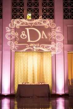 Wedding Reception Pink Uplighting and Projection GOBO of Bride and Groom